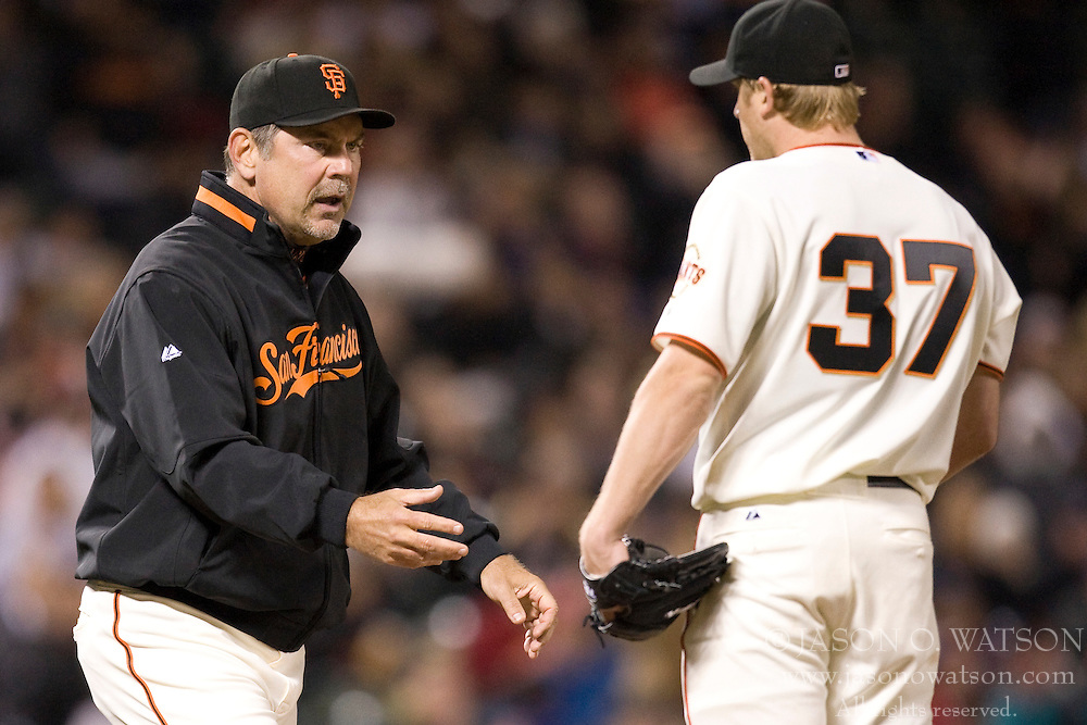 April 27, 2010; San Francisco, CA, USA;  San Francisco Giants manager Bruce Bochy (left) relieves relief pitcher Todd Wellemeyer (37) during the eighth inning against the Philadelphia Phillies at AT&T Park. San Francisco defeated Philadelphia 6-2.