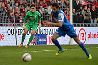 20131215 - LEUVEN, BELGIUM: Standard's goalkeeper Eiji Kawashima pictured in action during the Jupiler Pro League match between Standard de Liege and KRC Genk, in Liege, Sunday 15 December 2013, on the nineteenth day of the Belgian soccer championship. BELGA PHOTO JASPER JACOBS