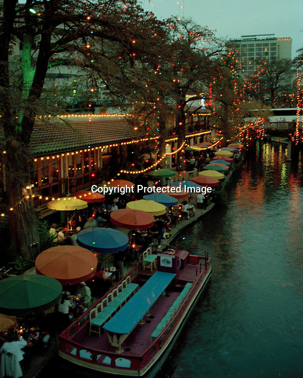 "View of the San Antonio Riverwalk in the late evening. NOTE: Click ""Shopping Cart"" icon for available sizes and prices. If a ""Purchase this image"" screen opens, click arrow on it. Doing so does not constitute making a purchase. To purchase, additional steps are required."