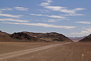 Africa, Namibia - Empty dry landscape headed toward Orupembe, in Kunene deep in the back country near the skeleton coast.