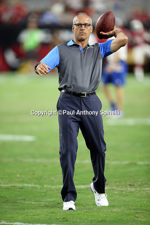 San Diego Chargers linebackers coach Mike Nolan throws a pass before the 2015 NFL preseason football game against the Arizona Cardinals on Saturday, Aug. 22, 2015 in Glendale, Ariz. The Chargers won the game 22-19. (©Paul Anthony Spinelli)