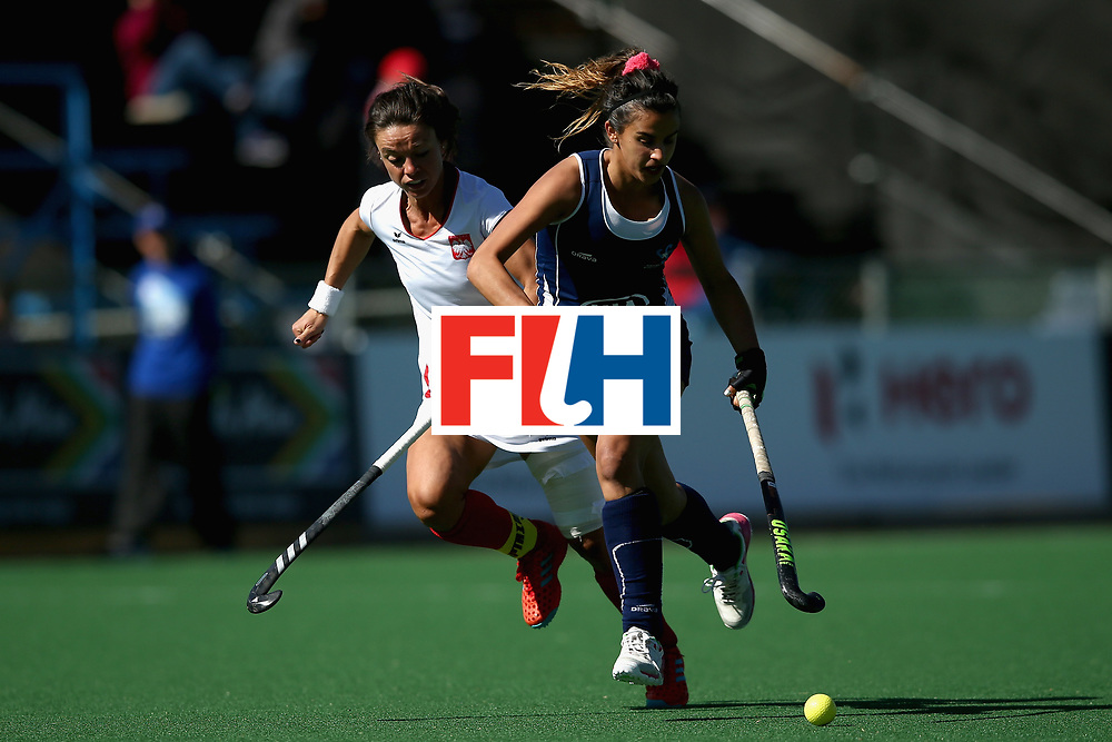 JOHANNESBURG, SOUTH AFRICA - JULY 20: Josefa Villalabeitia of Chile and Marlena Rybacha of Poland battle for possession during the 9th/10th Place playoff match between Poland and Chile during Day 7 of the FIH Hockey World League - Women's Semi Finals on July 20, 2017 in Johannesburg, South Africa.  (Photo by Jan Kruger/Getty Images for FIH)