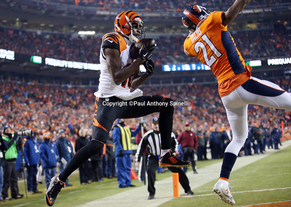 Cincinnati Bengals wide receiver A.J. Green (18) leaps and catches a five yard first quarter touchdown pass good for a 7-0 Bengals lead while covered by Denver Broncos cornerback Aqib Talib (21) during the 2015 NFL week 16 regular season football game against the Denver Broncos on Monday, Dec. 28, 2015 in Denver. The Broncos won the game in overtime 20-17. (©Paul Anthony Spinelli)