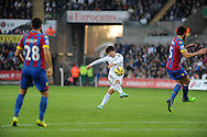 Ki Sung-Yueng has a go at the Crystal Palace goal for Swansea City.<br /> Barclays Premier league match, Swansea city v Crystal Palace at the Liberty stadium in Swansea, South Wales on Saturday 29th November 2014<br /> pic by Phil Rees, Andrew Orchard sports photography.