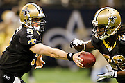 NEW ORLEANS, LA - DECEMBER 26:   Drew Brees #9 hands off the ball to Chris Ivory #29 of the New Orleans Saints during a game against the Atlanta Falcons at Mercedes-Benz Superdome on December 26, 2011 in New Orleans, Louisiana.  The Saints defeated the Falcons 45-16.  (Photo by Wesley Hitt/Getty Images) *** Local Caption *** Drew Brees; Chris Ivory