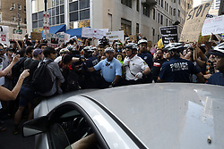 Government Vehicle operated by United States Secret Service agents attempts to drive trough a peaceful protest outside the hotel where VP mike Pence is visiting, on June 19, 2018, in Philadelphia, PA