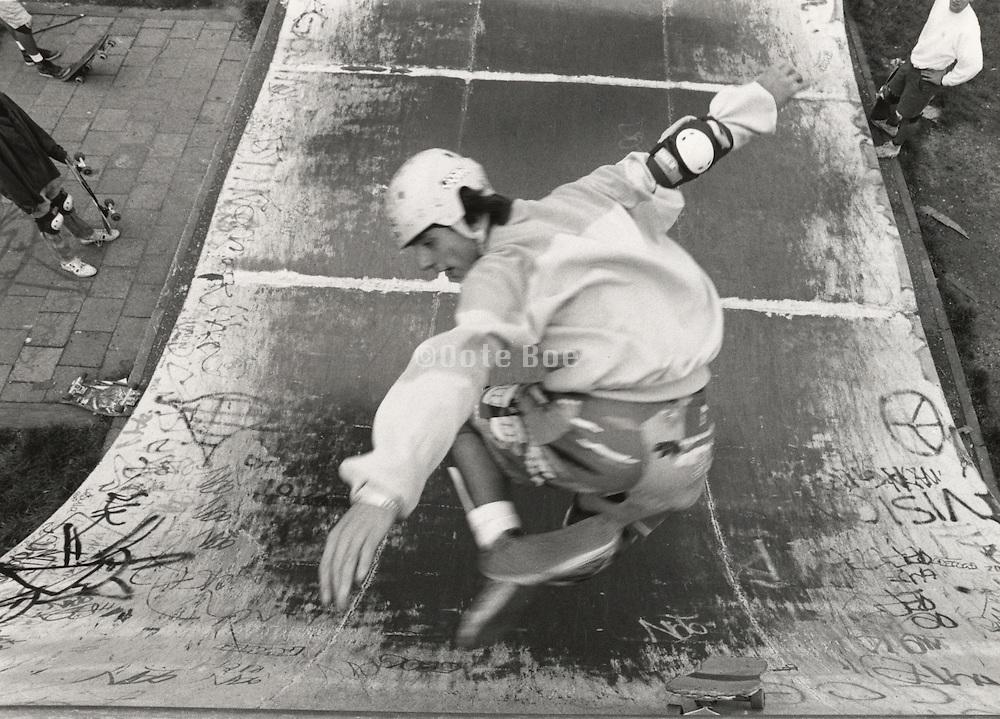 teenage boy executing skateboard maneuver