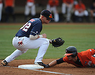 Mississippi's Mike Snyder (32) applies a tag to Virginia's Jarrett Parker (3), who dives back safely on a pick-off attempt during an NCAA Regional game at Davenport Field in Charlottesville, Va. on Saturday, June 5, 2010.