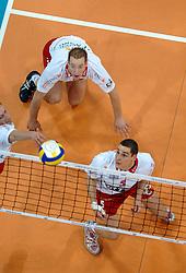 12-03-2005;VOLLEYBAL;FINAL4 TOP TEAMS CUP;ORTEC.NESSELANDE-OLYMPIACOS;ATHENE<br /> <br /> De mannen van ORTEC.Nesselande heeft het hoofd moeten buigen in de strijd om de Europese Top Teams Cup voor de thuis spelende sterrenformatie van Olympiakos Piraeus -<br /> <br /> <br /> <br /> &copy;2005-WWW.FOTOHOOGENDOORN.NL