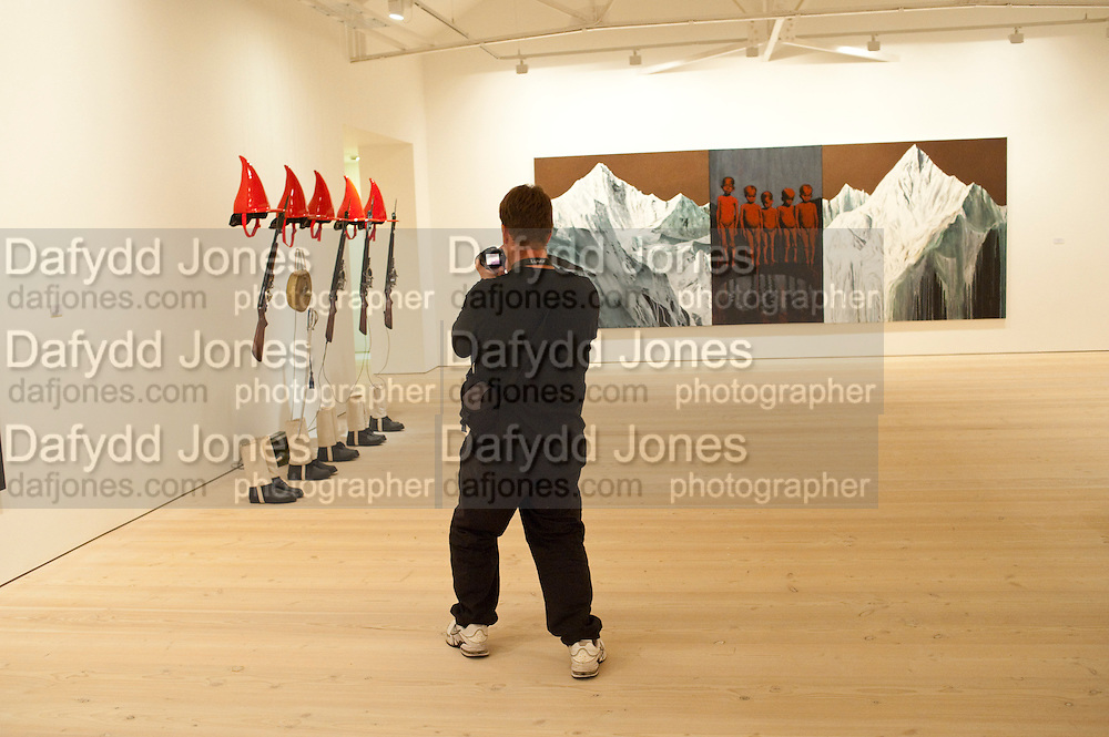 photographing art works, Gallerygoers viewing the Indonesian Eye Contemporary Art Exhibition, Saatchi Gallery. London. Saturday 10 September 2011. <br /> <br />  , -DO NOT ARCHIVE-© Copyright Photograph by Dafydd Jones. 248 Clapham Rd. London SW9 0PZ. Tel 0207 820 0771. www.dafjones.com.