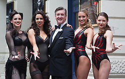"© Licensed to London News Pictures. 30/06/2012. London, England. L-R: Lauren Brooks, Djalenga Scott, Robin Cousins, Jenna Randall and Olivia Federici. Olympic Gold Medallist Robin Cousins poses with Jenna Randall and Olivia Federici from Team GB's Synchronised Swimming Team, whom he mentors, and dancers from the musical Chicago. Robin Cousins will take up the role of ""Billy Flynn"" in the musical Chicaco at the Garrick Theatre from 17 July 2012 for a limited season. Photo credit: Bettina Strenske/LNP"