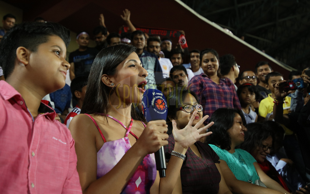 TV anchor interviewing at fans at gallery during match 18 of the Indian Super League (ISL) season 3 between NorthEast United FC and Chennaiyin FC held at the Indira Gandhi Athletic Stadium in Guwahati, India on the 20th October 2016.<br /> <br /> Photo by Saikat Das / ISL/ SPORTZPICS
