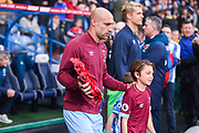 Pablo Zabaleta of West Ham United (5) enters the field of play with a wreath of poppies during the Premier League match between Huddersfield Town and West Ham United at the John Smiths Stadium, Huddersfield, England on 10 November 2018.