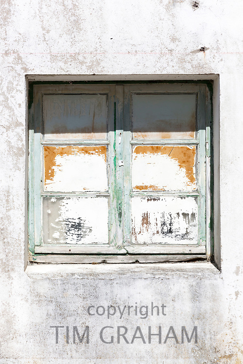 Typical weather worn paint on window on holiday island of Ile de Re, France