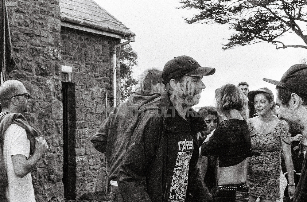 Hand print on a raver's face, , Upper chapel Rave, Brecon, Wales, August 2016.