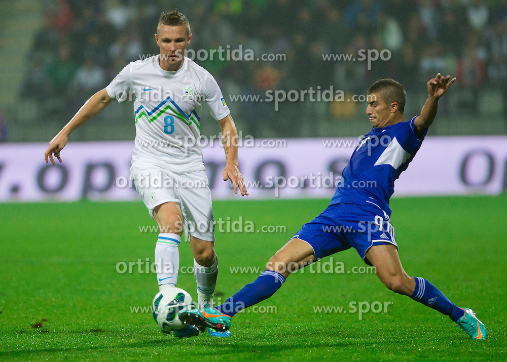 Jasmin Kurtic of Slovenia vs Dimitris Demetriou of Cyprus  during football match between National teams of Slovenia and Cyprus in 3rd Round of Group E of FIFA World Cup 2014 Qualification on October 12, 2012 in Stadium Ljudski vrt, Maribor, Slovenia. (Photo By Vid Ponikvar / Sportida)