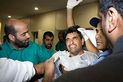 © under license to London News Pictures.  18/02/2011. A medic cries as protesters are brought into Salmnya Heath Complex in Manama, Bahrain to be treated after being shot by the police. Photo credit should read Michael Graae/London News Pictures