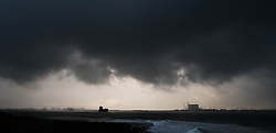 © Licensed to London News Pictures. 19/01/2014<br /> <br /> Teesside, England<br /> <br /> Heavy clouds form over Teesside as a container ship makes it's way along the River Tees and into the North sea.<br /> <br /> Photo credit : Ian Forsyth/LNP
