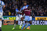 Felipe Anderson of West Ham United (8) under close attention from Philip Billing of Huddersfield Town (8) and Terence Kongolo of Huddersfield Town (5) during the Premier League match between Huddersfield Town and West Ham United at the John Smiths Stadium, Huddersfield, England on 10 November 2018.