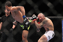 August 27, 2011; Rio De Janiero, Brazil; Edson Barboza (black trunks) and Ross Pearson (white trunks) during their bout at UFC 134 in Rio De Janiero.