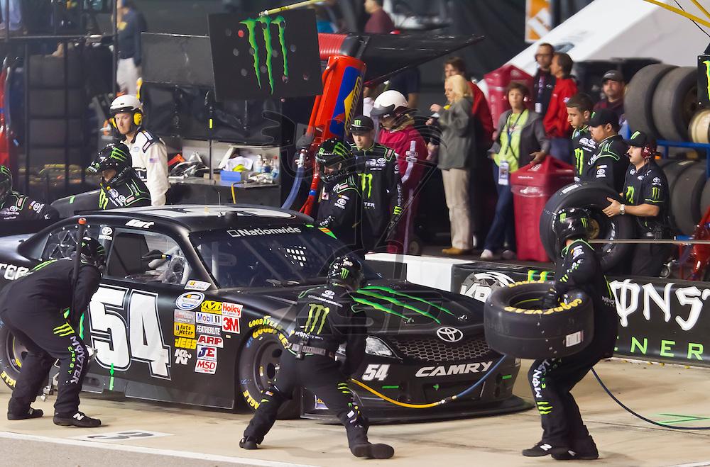 RICHMOND, VA - APR 27, 2012:  Kurt Busch (54) brings his Monster Toyota in for service during the Virginia 529 College Savings 250 at the Richmond International Raceway in Richmond, NC.