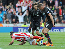Liverpool's Jordan Henderson fouls Stoke City's Erik Pieters- Photo mandatory by-line: Nizaam Jones/JMP - Mobile: 07966 386802 - 24/05/2015 - SPORT - Football - Stoke - Britannia Stadium - Stoke City v Liverpool - Barclays Premier League