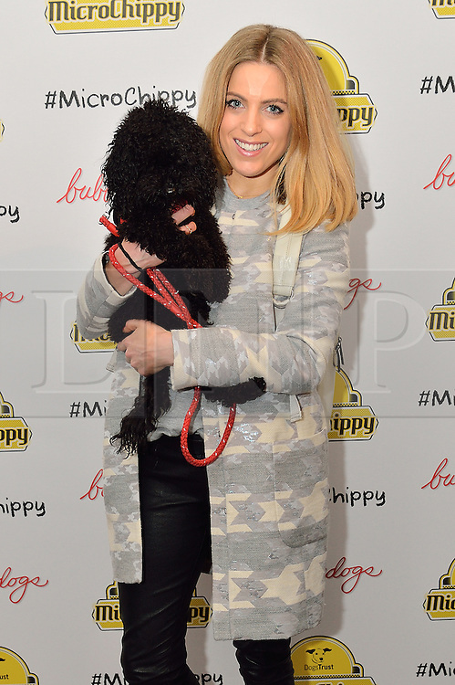 © Licensed to London News Pictures. 10/02/2016. OLIVIA COX with her dog Snoop attend the MicroChippy VIP Launch Party which aims to raise awareness of the upcoming change in dog microchipping legislation. London, UK. Photo credit: Ray Tang/LNP
