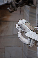 Milan, Italy, Duomo Cathedral - stone creature gargoyle on side of building.