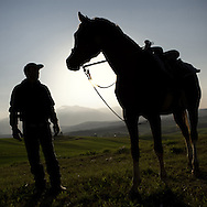 A man and his horse in the meadows of Castel Frentano (CH), not far forom the future construction site of a pylon of about 60 meters, higher than the Pisa tower.<br /> Castel Frentano (CH)