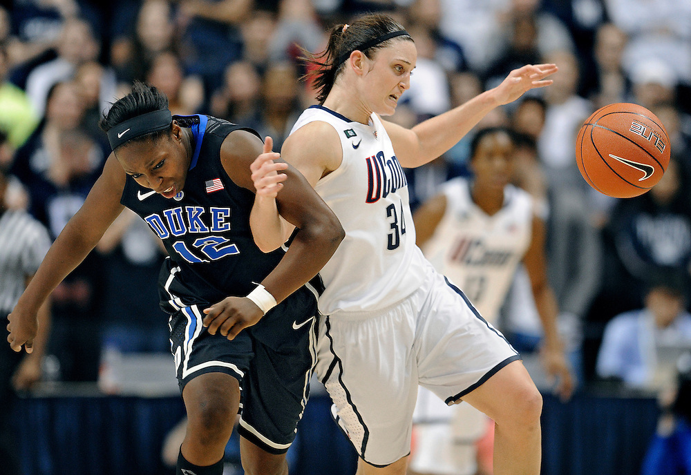 Duke's Chelsea Gray, left, and Connecticut's Kelly Faris tangle during the second half of an NCAA college basketball game in Storrs, Conn., Monday, Jan. 21, 2013. Connecticut won 79-49. (AP Photo/Jessica Hill)