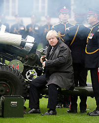 © London News Pictures. 05/11/2013 . London, UK.  Mayor of London BORIS JOHNSON, joined by members of the Armed Forces, firing a gun salute to launch London Poppy Day at The Honourable Artillery Company in London. The Mayor fired a salute from a 105mm light gun to launch this year's campaign, which aims to raise more than £1million in just one day. Photo credit : Ben Cawthra/LNP
