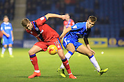 Steven Davies challenged by Jake Hessenthaler during the EFL Sky Bet League 1 match between Gillingham and Rochdale at the MEMS Priestfield Stadium, Gillingham, England on 26 November 2016. Photo by Daniel Youngs.