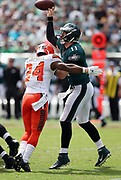 Philadelphia Eagles quarterback Carson Wentz (11) gets hit in the chest by Cleveland Browns defensive back Ibraheim Campbell (24) as he throws a second quarter pass for a short gain during the 2016 NFL week 1 regular season football game against the Cleveland Browns on Sunday, Sept. 11, 2016 in Philadelphia. The Eagles won the game 29-10. (©Paul Anthony Spinelli)