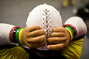 Lucha Libre AAA wrestler Mascarita Sagrada laces up his mask before a match in Sacramento, CA March 28, 2009.