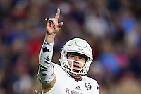 OXFORD, MS - NOVEMBER 26:  Nick Fitzgerald #7 of the Mississippi State Bulldogs signals to the fans after scoring a touchdown against the Mississippi Rebels at Vaught-Hemingway Stadium on November 26, 2016 in Oxford, Mississippi.  The Bulldogs defeated the Rebels 55-20.  (Photo by Wesley Hitt/Getty Images) *** Local Caption *** Nick Fitzgerald