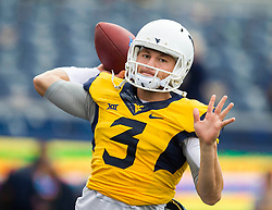Sep 12, 2015; Morgantown, WV, USA; West Virginia Mountaineers quarterback Skyler Howard warms up before their game against the Liberty Flames at Milan Puskar Stadium. Mandatory Credit: Ben Queen-USA TODAY Sports