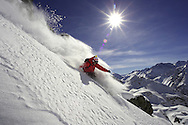 Skier turning in fresh powder snow, Serre Chevalier, France