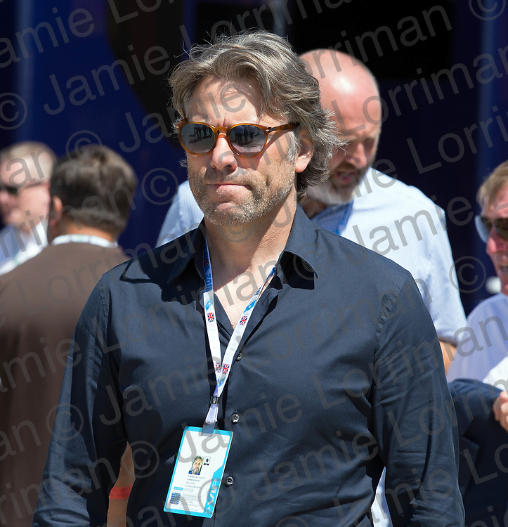 The 2018 Formula 1 F1 Rolex British grand prix, Silverstone, England. Sunday 8th July 2018.<br /> <br /> Pictured: Comedian John Bishop in the paddock ahead of the race at Silverstone.<br /> <br /> Jamie Lorriman<br /> mail@jamielorriman.co.uk<br /> www.jamielorriman.co.uk<br /> 07718 900288