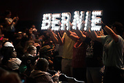 "Fans hold up ""Bernie"" lights for the crowd before Bernie Sanders speaks at the Verizon Theater in Grand Prairie, Texas on April 19, 2017. (Cooper Neill for The Texas Tribune)"