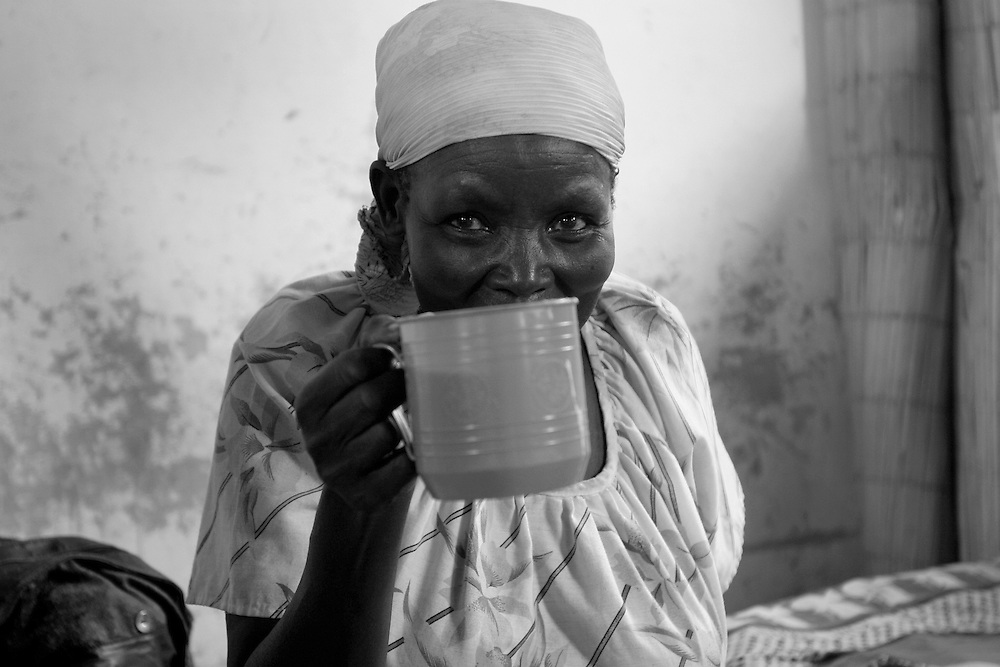 Old lady at the CBL Center of Bujumbura ( Center for injured people)  eating her soup.  @ Martine Perret .24 .October 2005.