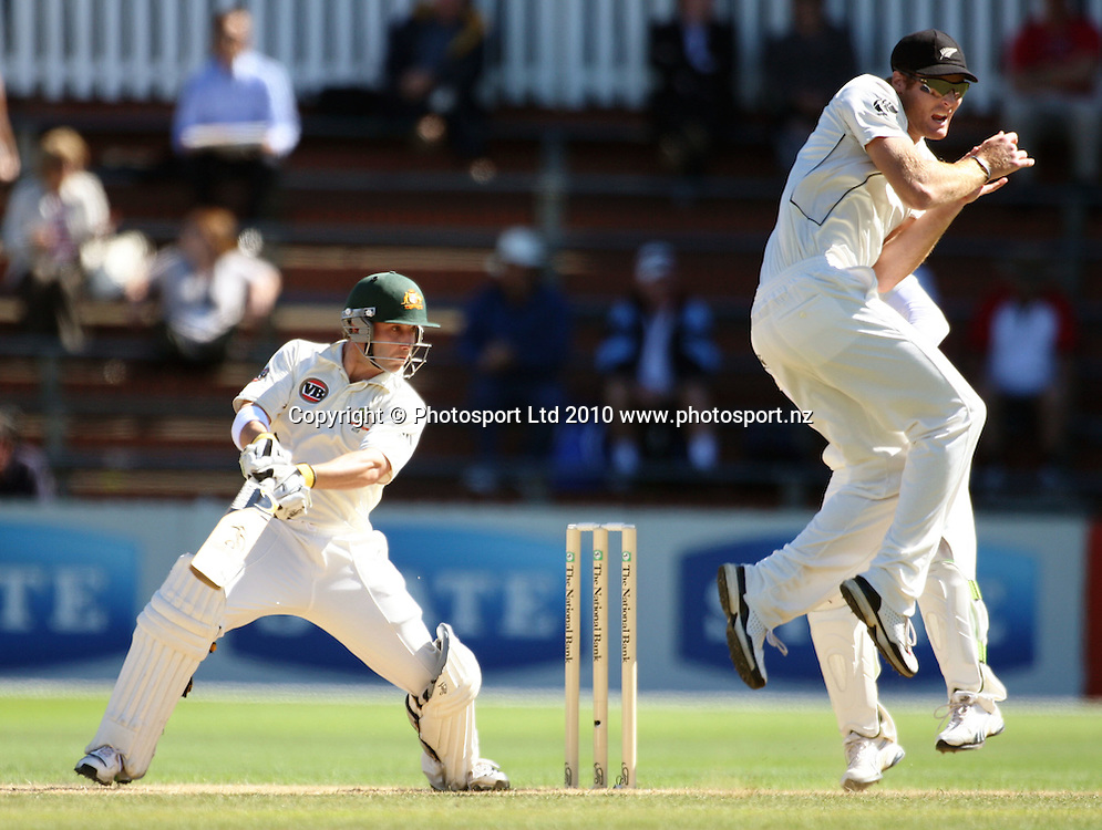 Martin Guptill takes evasive action as Australian opener Phil Hughes hits out.<br /> 1st cricket test match - New Zealand Black Caps v Australia, day five at the Basin Reserve, Wellington. Tuesday, 23 March 2010. Photo: Dave Lintott/PHOTOSPORT