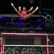 Gabrielle Douglas of the United States soared over the uneven bars apparatus during women's team gymnastics finals at North Greenwich Arena during the 2012 Summer Olympic Games in London, England, Tuesday, July 31, 2012. The United States won the gold medal in the event. (David Eulitt/Kansas City Star/MCT)