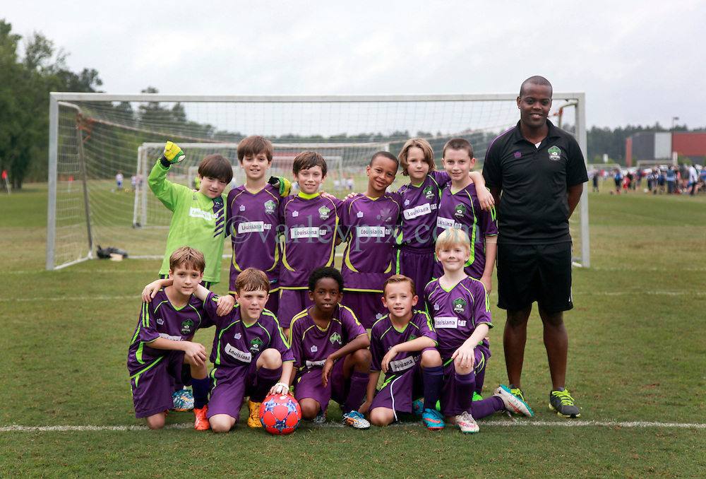 11 April 2015. Hammond, Louisiana.<br /> U9 New Orleans Jesters Elites, team purple at the Strawberry Cup hosted by the South Tangipahoa Youth Soccer Association (STYSA).<br /> Photo; Charlie Varley/varleypix.com