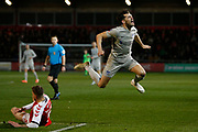 John Marquis of Portsmouth is tackled by Ashley Eastham of Fleetwood Town during the The FA Cup match between Fleetwood Town and Portsmouth at the Highbury Stadium, Fleetwood, England on 4 January 2020.