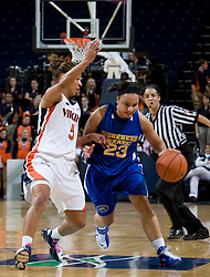 Morehead St. guard Anitha Smith-Williams (23) is guarded by Virginia guard Sharnee Zoll (5).  The Virginia Cavaliers women's basketball team defeated the Morehead State Eagles 88-43 at the John Paul Jones Arena in Charlottesville, VA on February 4, 2008.