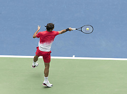 August 31, 2017 - New York, New York, United States - Roger Federer of Switzerland serves during match against Mikhail Youzhny of Russia at US Open Championships at Billie Jean King National Tennis Center  (Credit Image: © Lev Radin/Pacific Press via ZUMA Wire)