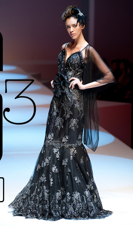 HONG KONG - JANUARY 18:  A model showcases designs by Diana Lin on the catwalk during the Taiwan Textile Federation show as part of the  Hong Kong Fashion Week Fall/Winter 2010 on January 18, 2010 in Hong Kong.  Photo by Victor Fraile / studioEAST