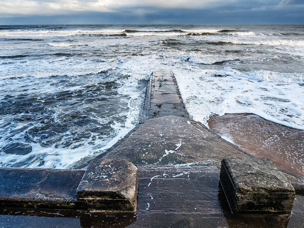Concrete Breakwater at High Tide in South Bay at Scarborough North Yorkshire England