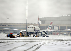 © Licensed to London News Pictures. 05/02/2012, London, UK. A plane with snow on its windscreen. Planes in the snow at Heathrow Airport today 05/02/12. The airport has cancelled a third of its flights because of the snow. Heavy snow has fallen over many parts of the UK overnight. Photo credit : Stephen Simpson/LNP