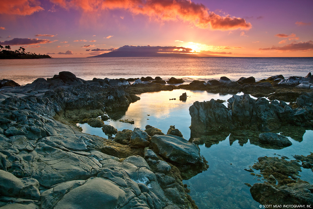 Sunset by rocks and water from Napili Bay, West Maui, Hawaii